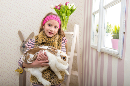 fondle: Easter - Girl carries a huge rabbit live