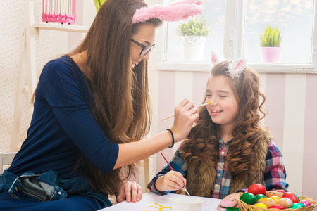 bunny ears: Easter - Mother and daughter paint eggs, bunny ears on them