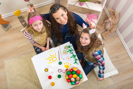Easter - Mother and two daughters in preparation for Easter photo