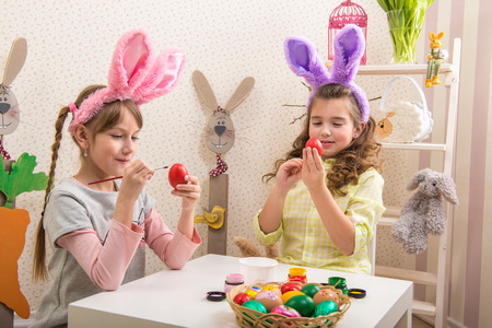 Little girls are made of Easter - they paint, they draw in the Room photo