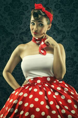 clothes interesting: Vintage style  Woman looks interesting in polka dots clothes