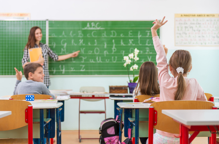 Teacher and students in the classroom: teaching,