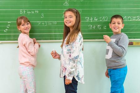 Teacher and student at the blackboard, math class Stock Photo