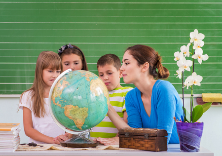 Children learn in school from the globe, Geography