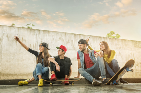 urban style: Skateboarder  Couples made selfi photo Stock Photo