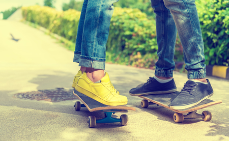 boy skater: Skateboarder detail photo, womens and mens feet