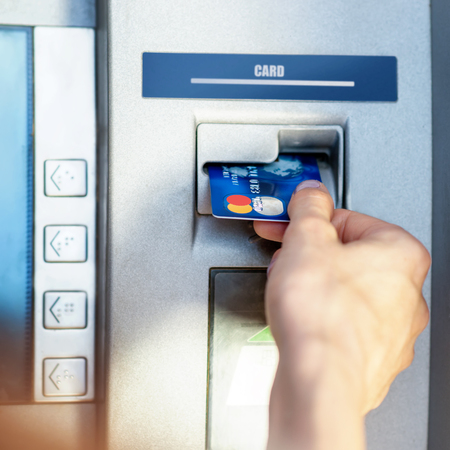 withdrawals: Female hand - close up - cash withdrawals at ATMs Stock Photo