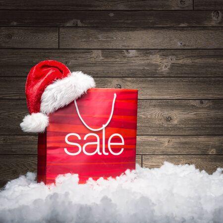 rebate: Christmas - Sale bag , rebate ,on wood background