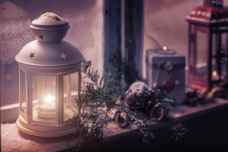 white window: Christmas - candles glow in the steamy window Stock Photo