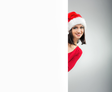 female christmas: Women Christmas, looks out from behind the table