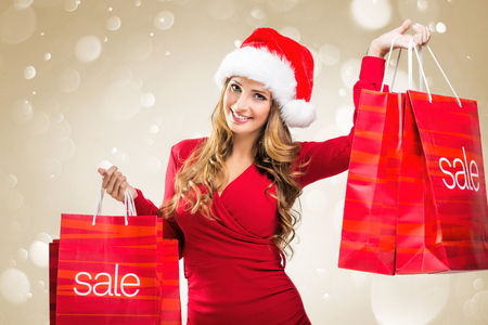 santa girl: Christmas SALE - woman holding a red sale bags