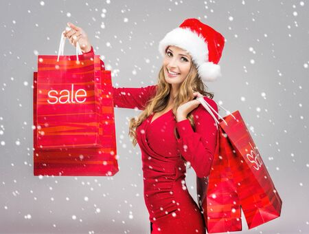 rebates: Christmas SALE - woman holding a red sale bags