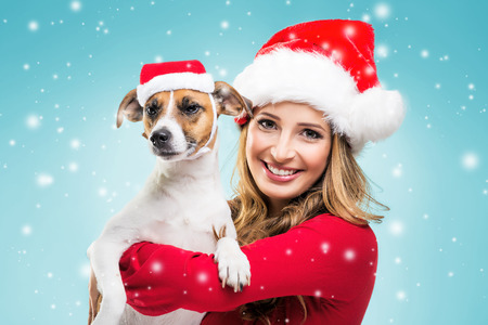 Women with dog in Christmas Santa Hat