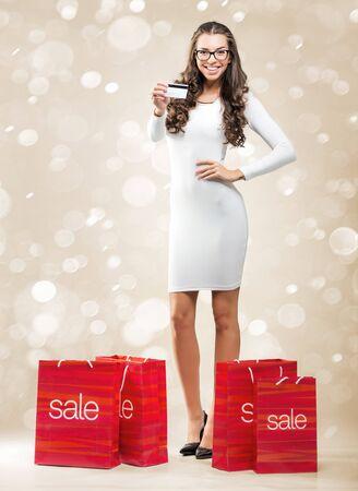 rebates: Business woman holding credit card