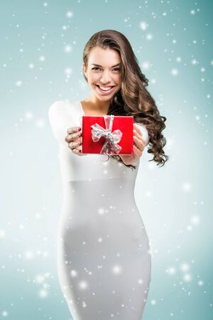 rebates: Woman shows red gift box for you