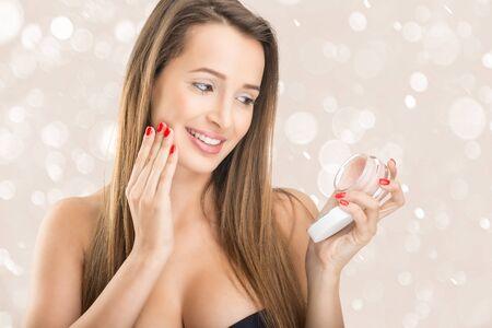 woman face cream: Skin Care - Beautiful woman with face cream Stock Photo
