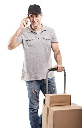 carretilla de mano: Durante una llamada - cajas y paquetes de máquinas mano de Correo Foto de archivo