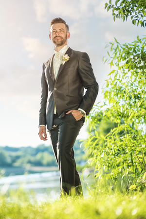 Young handsome groom portrait in nature