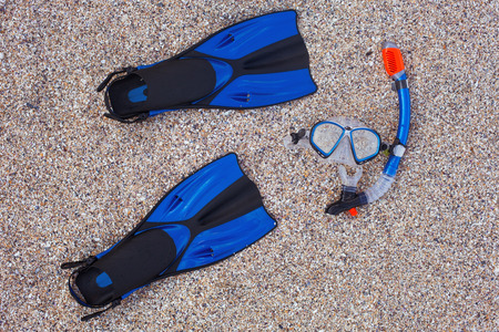 scubadiving: Snorkeling set. Mask and swim flippers on a sand beach Stock Photo