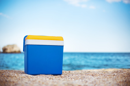 cooler: Cooler box on the sea sand