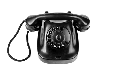 rotary dial telephone: Blck retro-styled telephone isolated on white background Stock Photo