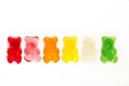 Childhood and jelly bears candies isolated on white background Imagens
