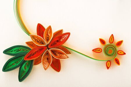 quilling: Paper flower on a greeting card made with quilling technique