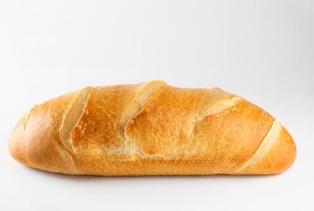 loaf: Freshly backed french bread isolated on white background