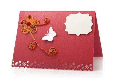 quilling: Paper card or table signboard made with quilling technique isolated on white background