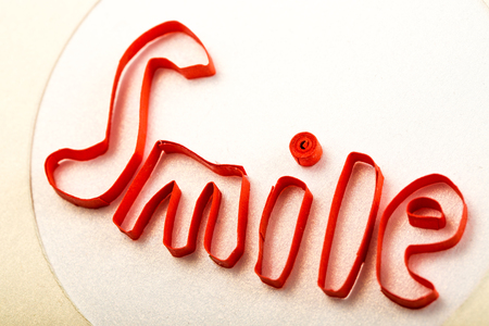 quilling: Smile text made with quilling technique closeup studio shot Stock Photo