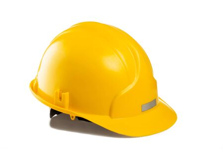 isolated on yellow: Yellow construction and industrial helmet isolated on white background Stock Photo