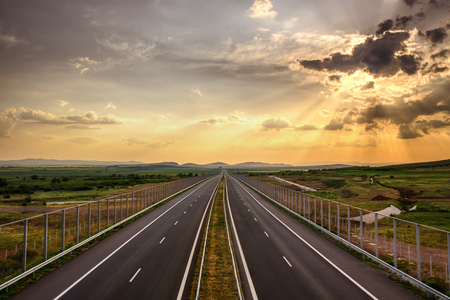 country highway: Highway traffic in sunset, travel concept background