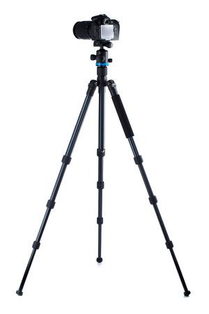 Photo camera on tripod isolated over white background