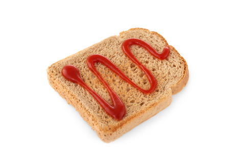 slices of bread: Slice of dark bread with ketchup isolated on white background Stock Photo