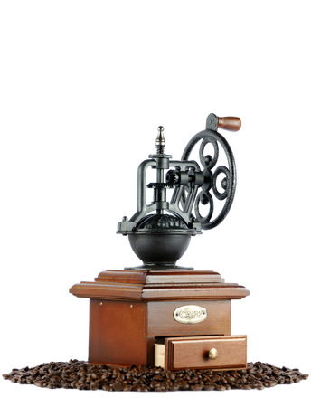 coffee grinder: old-fashioned coffee grinder with beans isolated on white backgrounds