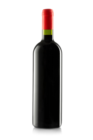Red wine and a bottle isolated on white background