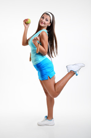 jump rope: Young Happy Girl with apple and Jump Rope training on White background Stock Photo
