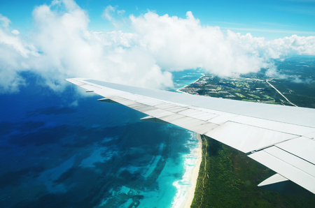 flight: Beautiful aerial view from the plane over Punta Cana, Dominican Republic