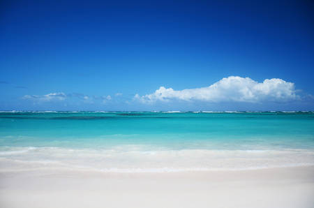 shorebreak: Exotic tropical beach and beautiful cloudscape