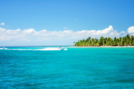 speedboat: Adventure speedboat in the blue carribean sea near Saona island, Dominican Republic Stock Photo