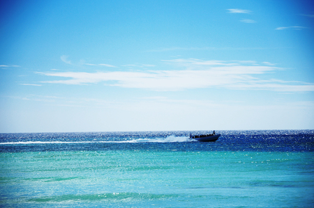 carribean: Adventure speed boat sailing in the blue carribean sea and cloudscape