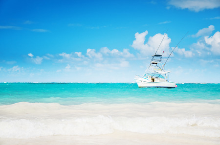 carribean: Sailing yacht near the coastline at the blue carribean sea Stock Photo
