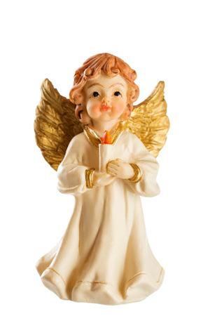 ange gardien: Petite figure d'un ange de No�l avec bougie isol� sur fond blanc
