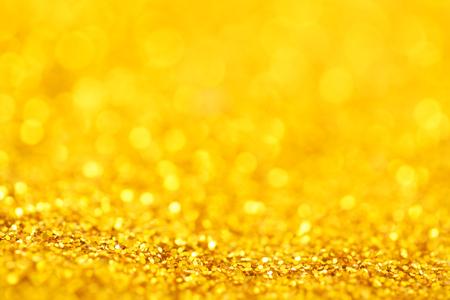 golden light: Abstract golden background texture close up