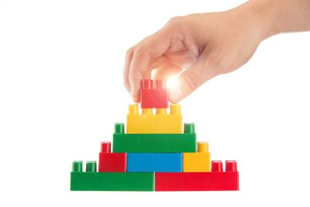 yellow lego block: Plastic building blocks and hand Stock Photo