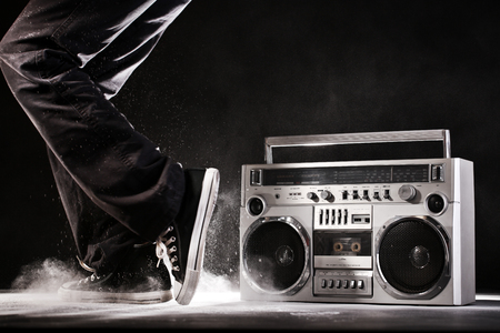 rap music: Retro ghetto blaster, dust and dancer isolated on black background