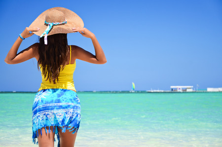 dominican: Beautiful woman looking at the sea and enjoying her holiday vacantion in Punta Cana, Dominican Republic Stock Photo