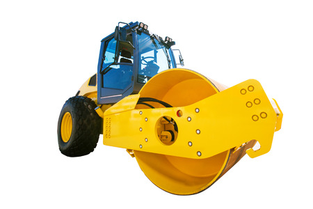 blacktopping: Big modern yellow road roller heavy construction machine isolated on white background Stock Photo