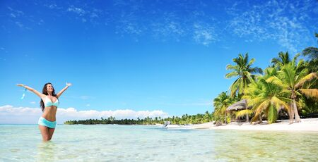 tropical beach panoramic: Carefree young woman relaxing on tropical beach, panoramic view
