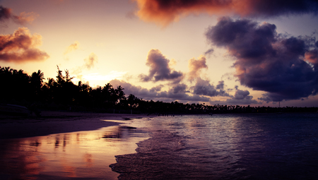 Dramatic sunset over the exotic beach in Punta Cana, Dominican Republic Stock Photo
